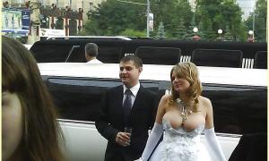 Невеста с большой грудью в откровенном свадебном платье фото
